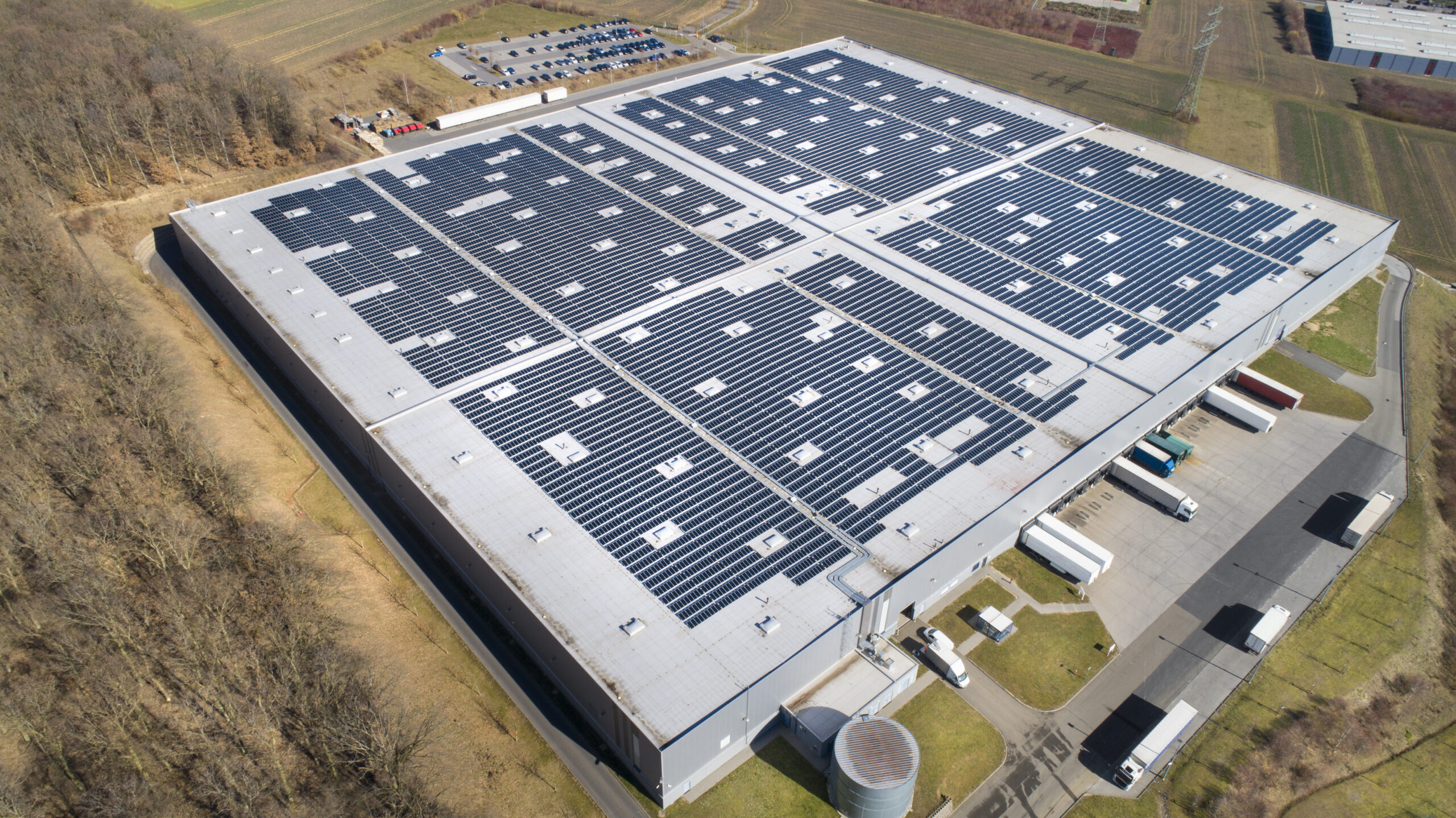 Install solar panels on commercial buildings